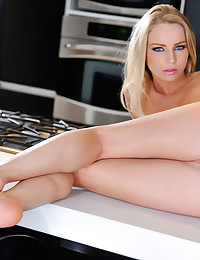 Staci Carr moans from rubbing her sexy pussy at the kitchen