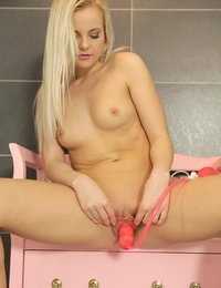 Gorgeous blonde Layla rides a big black dildo