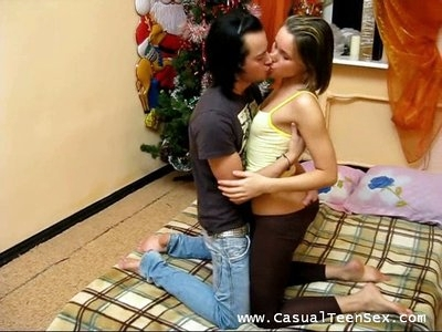 This couple just started living together and they do not have much furniture still. They celebrated that New Year in an empty room just with a bed and a New Years tree. But they did not give up and enjoyed the holiday to the full. They simply pleased each other with oral games and a furious sex.