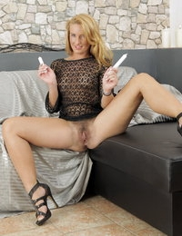 Gorgeous blonde toys her pussy with sex toys