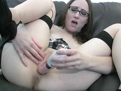 Brunette college girl Crystal Clark in sexy stockings and stuffing her twat with a dildo