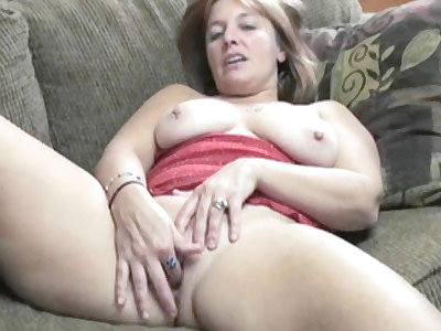 Curvy redhead housewife Liisa in red lingerie and playing with her mature pussy