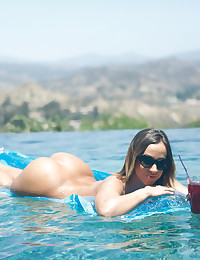 Tanned hottie Jada Stevens uses her talented mouth and landing strip pussy to take her man for a wild poolside ride