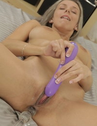 Both holes are filled in this solo sex toy scene