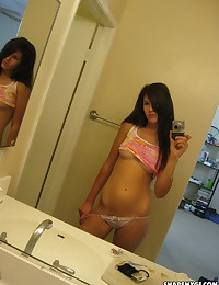 Cute girlfriend teases with under boob selfshot pictures in the mirror