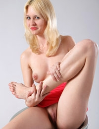 Blonde Marta sure loves to tease with her nude forms and shaved pussy