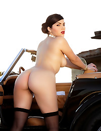 Treat for May, Valentina Nappi, strips off her clothes as she gets horny posing