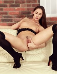 Gorgeous brunette toys her pussy with sex toys