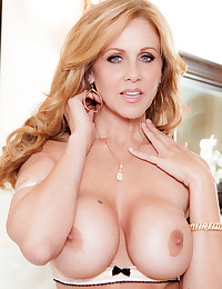 Busty goddess Julia Ann plays with her hot snatch