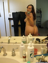 Cute chubby naked girlfriend takes selfshot pictures of her big perky tits