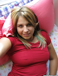 Cute chubby girl takes selfshot pictures in bed of her perky tits and round ass