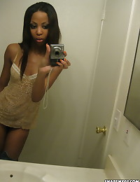 Sexy black girlfriend shows off her perky tits in selfshot mirror pictures her boyfriend uploaded for us