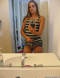 Cute girlfriend shows off her perky tits and round ass as she takes selfshot mirror pictures