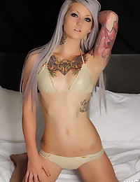 Tattooed Alluring Vixen babe Cambria shows off her tight little curves while waiting in bed