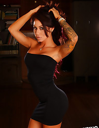 Stunning tattooed Alluring Vixen babe Venessa shows off her perfect curves in a tight short dress
