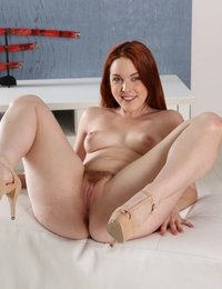 Beautiful redhead shows off her hairy pussy