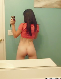 Slutty girlfriend isn't shy as she takes selfshot pictures in the mirror