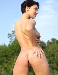 Busty Cecelia heat your imagination curving nude on the sand