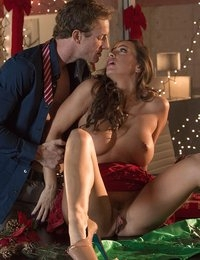 As the office Christmas party wrapped up, Abigail Mac found herself all alone at her desk, wishing she had a certain someone to take her to bed for a magical night. While she dreamed of Prince Charming, Abigail's boss Ryan McLane noticed her moping and swooped in to see if his attraction to her was mutual. After going in for the kiss and unzipping her dress, Ryan went down on Abigail, licking her pussy until Abigail couldn't wait another second to have him deep inside her. Abigail climbed on and rode Ryan's cock, then dropped down to suck him off until he sprayed his load all over her face. How did their colleagues react when they walked in to see Abigail on her knees with a big cumshot running down her lips? You'll have to watch this hot scene to find out!