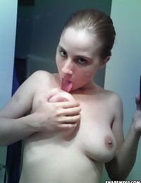Busty nerdy girlfriend takes selfshot pictures for her boyfriend in the mirror