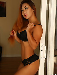 Busty Alluring Vixen babe Darling Darla teases with her perfect curves in a skimpy black lace bra and panties