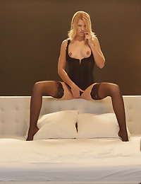 Watch lovely Izzy's eye contact with her man as she slithers on the bed and begins to get naked.   Doesn't she look fabulous in those sexy black tights?   She wants to fuck, but not just a wham-bam tryst.  First, some foreplay as he licks her delicious pussy and she sucks cock for maximum pleasure.  Then, she mounts her lover and begins to do him face-to-face.  What a beautiful sight.  Then she rolls over on her tummy and he enters her for more intense fucking.   Notice how perfectly tight Izzy's ass is -- and her flat stomach, the lovely arch of the back, and those high cheekbones on that unforgettable face.  Listen and enjoy as Izzy has even more orgasms missionary style.   It's getting hot in her -- I mean, here!