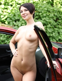 Busty short-haired Cecelia makes an extremely sexy posing by a car