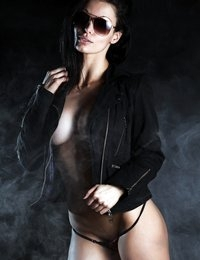 Angelina Stevens posing behind a curtain of smoke