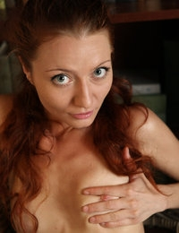 Redhead model Kesy is proud to demonstrate her arousing bubble ass