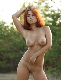 Hot redhead angel with big tits April looks arousing on her outdoor pics