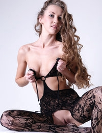 Blonde nympho Larisa looks overwhelming in her black fancy lingerie
