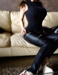 Barbara Belize in a skin tight leather outfit