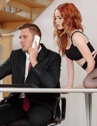 You couldn't expect Marc Rose to turn down the advances of his secretary Ella Hughes when she barged into his office to relieve his stress with a naughty striptease and lap-dance. By the time that saucy redhead had peeled down her dress, and crawled below Marc's desk wearing little more than garters and stockings, he was desperate to feel her mouth on his throbbing cock. Ella didn't stop teasing him even when the boss walked by and nearly caught them, then she kept tugging and sucking Marc's hard-on. Ella straddled Marc on the couch, riding him cowgirl as he squeezed big handfuls of her thick butt. Marc bent Ella over his desk and spanked her, then licked her asshole and pounded her from behind until he painted her lips with a massive load!