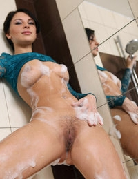 Stunning Cecelia foams her long legs and pussy in a bathroom