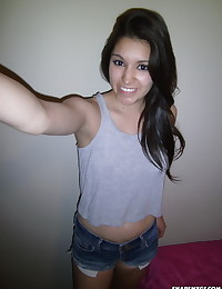 Horny girlfriend shows off her ready to fuck ass as she pulls down her jean shorts as her boyfriend takes pictures for us