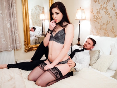 Kinky looking Amber Nevada pleasured by her man in a bed.
