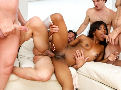 Sarah takes on four big white cocks filling all her holes