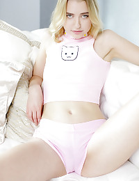 Blonde cutie Chloe Couture is a college coed who loves fashion, cats and romantic sex. The girl with the soulful eyes flashed a beguiling smile when I suggested that she slip out of her tiny pink outfit and play with her very own kitty. Chloe loves the feel of a cock in her mouth and inside her pussy, and a very large dick-shaped toy soon caught her attention.