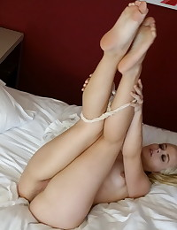 Petite blonde girlfriend strips naked for her boyfriend in his hotel room