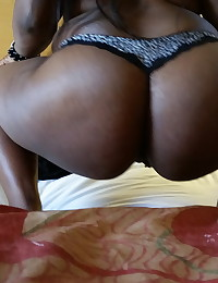 Chubby black girlfriend shows off her big booty in a tiny thong as she strips naked