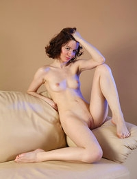 Stunning lady Tinka with white skin looks awesome on her erotic pics