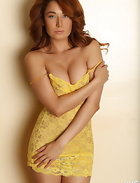 Perfect Alluring Vixen babe Lilly shows off her curves in a skimpy yellow lace dress
