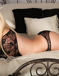 Sexy Alluring Vixen blonde Ashlee Madison teases in her skimpy black lace outfit as she lays on the bed waiting