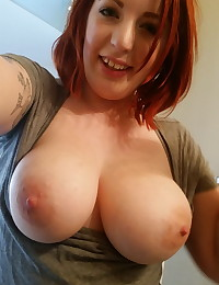 Chubby girlfriend shows off her big natural tits as she takes selfies in the mirror