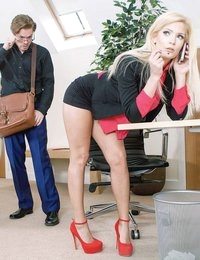 A good mail-room clerk has to be punctual and efficient -- luckily for Ryan Ryder, his charm and good looks are enough to make up for his clumsiness. When he fumbled Candee Licious's mail delivery, he thought he was in hot water, until she bent all the way over her desk and gave him an upskirt peek at the juicy crescent shape of her ass cheeks spilling out from her mini-skirt. When Candee caught him peeping, she pounced on him, letting him know that his constant voyeur spying in the office got her so horny, fucking the mail-boy had become her ultimate office sex fantasy. Candee got on her knees to suck on Ryan's fat cock, riling him up with her skillful oral sex to the very brink of orgasm, then walking him back down. Leaving her red high heels on as she stripped naked in her office, Candee jumped on Ryan's hard dick, riding him reverse cowgirl while the pleasure of every deep thrust made her scream so loud the boss came by and caught them in the act!