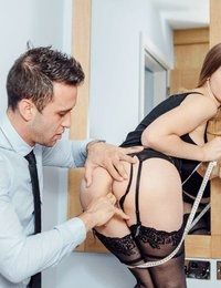 Customer service is what sets Stella Cox's tailor service apart, her hands-on approach to pleasing any customer who comes in looking for a suit made-to-measure. When Kai Taylor walked into her shop, a frisson of erotic desire rippled through Stella's crotch, and she just had to get her hands on his athletic body that very minute. Stella held it together long enough to pull her measuring tape across his broad back, but when she pulled the tape up his leg, she fixated on the shape of his cock bulging against his trousers. Once Stella got her hands on Kai's impressive cock, she had to see if she could deepthroat every inch, then she let Kai facefuck her mouth. Watch how Kai filled Stella up, her big natural boobs bouncing as she road his cock on the floor of her workshop!