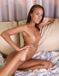 Naughty tanned brunette Hazel showing pink pussy