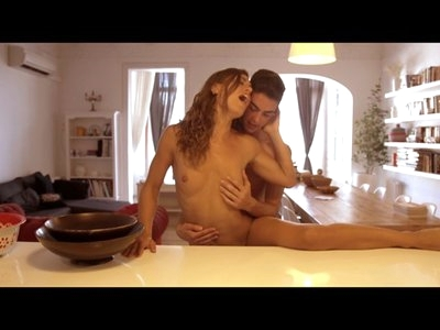 A bra and panties are all that cover Julia Roca as she pours herself a glass of milk. Vic Leon is in an equal state of dishabille, making it an easy decision for Julia to tease her boyfriend. Peeling off her bra, Julia covers her small boobs in milk that Vic is eager to lick off.Helping Julia up onto the counter, Vic peels off her panties in preparation for a great time. He dives into her hairy pussy without hesitation, putting his tongue to work pleasuring and teasing her tender clit and juicy slit. He's quick to get his hand in on the action, making sure that every moment is bliss for his lover.Julia loves the feel of Vic's tongue on her most intimate places, but she's not about to let him have all the fun. Reaching down, she grabs Vic's stiffie and starts rubbing him with the same enthusiasm that he has used for her. It's not long before they are both totally aroused and ready to fuck!Helping Julia to her feet and then bending her forward over the island, Vic slides into her tight twat from behind. Her juicy fuck hole is the perfect fit for his hardon as he pumps his hips, loving every slip and slide in and out of her wetness. Julia's long moans and smiling kisses affirm how much she is enjoying her boyfriend's attention.Taking things to the couch, Julia puts that laughing mouth to work licking along Vic's hard shaft and then engulfing the tip of his fuck stick. After working herself towards taking him deeper with each bob of her head, Julia is soon deep throating like a champ. She takes her time playing with Vic's cock, enjoying every salty inch before urging him to the floor where she can climb into his lap and slide down until her hairy snatch is fully impaled by his stiffie.Even when Julia falls to the side from her exertions riding her lover, Vic isn't about to let the pleasure end. Wrapping his arms around his woman, he keeps on fucking in the spooning position. The only break he allows himself is to let Julia climb back onto the couch so that she can prope