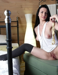 Brunette babe Felicia spreading legs and showing her hairy pussy