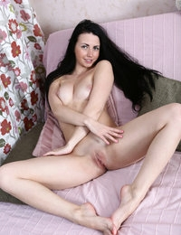 Very beautiful brunette babe Felicia posing naked on her bed